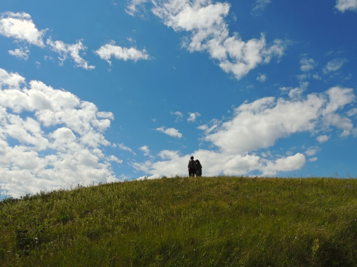 Young Hutterite couple enjoying the view at Bald Butte