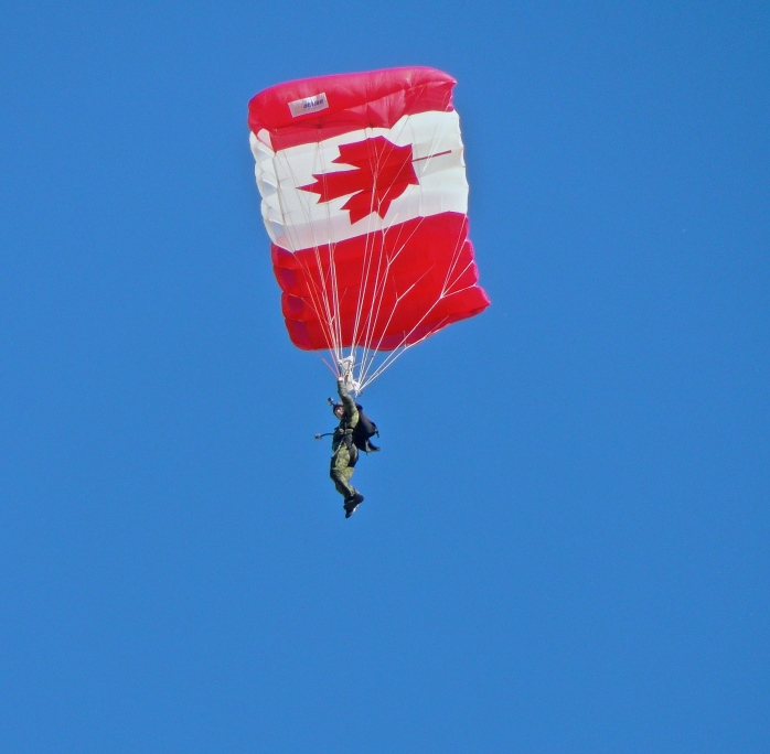 The half-time show at the Labour Day Classic between the Saskatchewan Roughriders and the Winnipeg Blue Bombers was parachutists from 15 Wing Moose Jaw competing to see who could land on target at mid-field.  I thought they looked liked little miniature army men falling from the sky