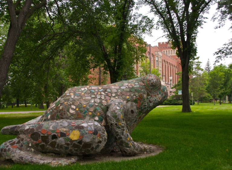 I've walked by the frog at the U of R College Avenue Campus many times, but I didn't realize all the detail on the sculpture until I walked up to it. But then I freaked out when a mouse scurried out from under it and that made me shriek, but I'm not afraid of squirrels or gophers, so why would I get freaked out by a tiny mouse?  That's my deep thought o the day. :)
