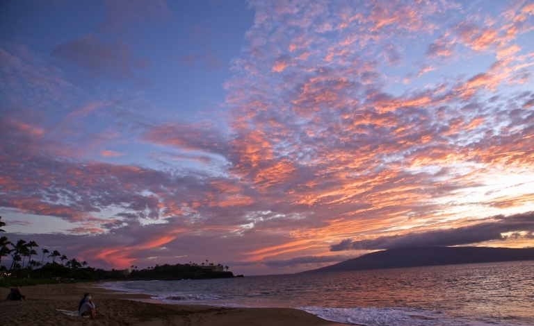 watching the sunset on Kaanapali Beach